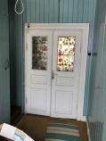 Spegeldörrarna med målat fönsterglas in till finrummet i Skeppshandeln. Foto: Jennie Björklund ©Norrbottens museum